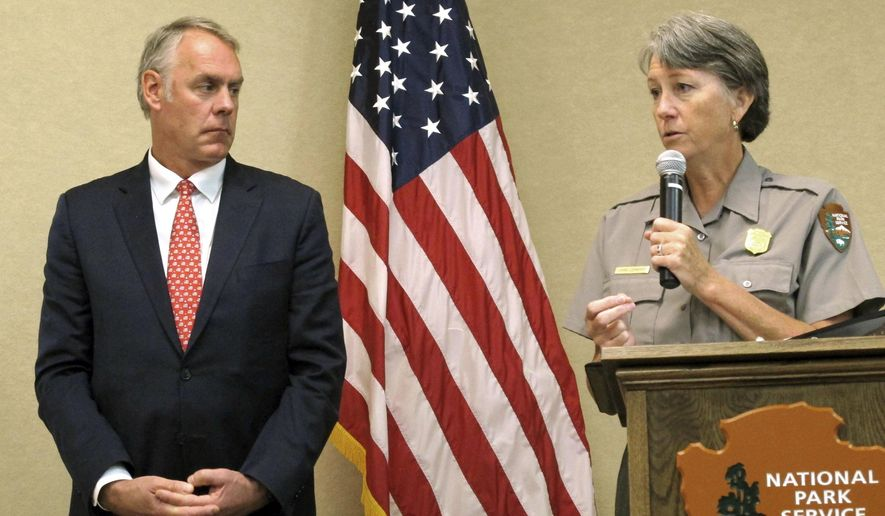 Interior Secretary Ryan Zinke, left, and Grand Canyon National Park Superintendent Chris Lehnertz address National Park Service employees Friday, Oct. 13, 2017, at Grand Canyon National Park, Ariz. A survey of Park Service employees found nearly two in five have experienced some sort of harassment or discrimination in the workplace. (AP Photo/Felicia Fonseca)