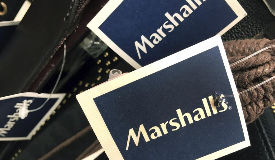 In this Tuesday, May 16, 2017, photo, Marshalls tags are attached to merchandise in a store in Methuen, Mass. On Friday, Oct. 13, 2017, the Commerce Department releases U.S. retail sales data for September. (AP Photo/Elise Amendola)