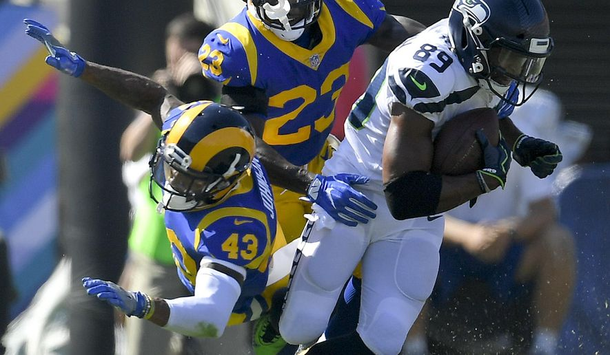 Seattle Seahawks wide receiver Doug Baldwin, right, breaks away from Los Angeles Rams defensive back John Johnson, left, and cornerback Nickell Robey-Coleman during the first half of an NFL football game Sunday, Oct. 8, 2017, in Los Angeles. (AP Photo/Mark J. Terrill)