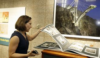 Michelle Light, director of special collections and archives at the UNLV University Libraries, leads a tour of UNLV's special collections and archives at Lied Library on Sept. 15, 2017, in Las Vegas.   (Bizuayehu Tesfaye/Las Vegas Review-Journal via AP)