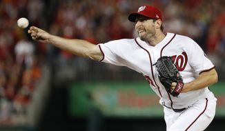 FILE - In this Thursday, Oct. 12, 2017, file photo, Washington Nationals relief pitcher Max Scherzer (31) throws during the fifth inning in Game 5 of baseball's National League Division Series against the Chicago Cubs, at Nationals Park in Washington. When a starter is called in to pitch in relief, his routine can be a lot different, and perhaps more importantly, he's often working on short rest. So far in this postseason, the results have been decidedly mixed. (AP Photo/Alex Brandon, File)