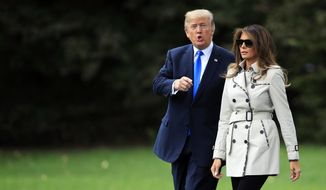 President Donald Trump and first lady Melania Trump walk on the South Lawn of the White House in Washington, Friday, Oct. 13, 2017, to board the Marine One to visit the United States Secret Service James J. Rowley Training Center in Beltsville, Md. (AP Photo/Manuel Balce Ceneta)