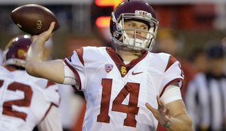 FILE - In this Sept. 23, 2016, file photo, Southern California quarterback Sam Darnold (14) passes the ball against Utah in the first half during an NCAA college football game in Salt Lake City. Before Darnold led USC on a 13-game winning streak that made him a Rose Bowl champion and a Heisman Trophy contender, the quarterback made his first career start against Utah last season and lost, Darnold gets a chance to right one of the few wrongs against him on Saturday night when the No. 13 Trojans host the Utes to decide the clear front-runner in the Pac-12 South. (AP Photo/Rick Bowmer, File)