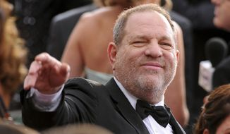 In this Feb. 22, 2015 file photo, Harvey Weinstein arrives at the Oscars at the Dolby Theatre in Los Angeles. On Saturday, Oct. 14, 2016, the Academy of Motion Picture Arts and Sciences revoked Weinstein's membership. The decision, reached Saturday in an emergency session, comes in the wake of recent reports by The New York Times and The New Yorker magazine that revealed sexual harassment and rape allegations against him going back decades.(Photo by Vince Bucci/Invision/AP, File)