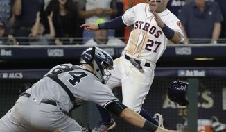 Houston Astros' Jose Altuve scores the game-winning run past New York Yankees catcher Gary Sanchez during the ninth inning of Game 2 of baseball's American League Championship Series Saturday, Oct. 14, 2017, in Houston. The Astros won 2-1 to take a 2-0 lead in the series. (AP Photo/David J. Phillip)