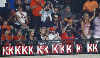 Fans display 13 K's for the number of strikeouts Houston Astros starting pitcher Justin Verlander had during the ninth inning of Game 2 of baseball's American League Championship Series against the New York Yankees Saturday, Oct. 14, 2017, in Houston. (AP Photo/Eric Gay)