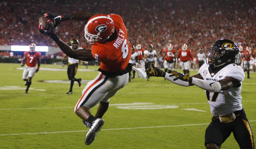 Georgia wide receiver Riley Ridley (8) makes a catch for a touchdown as Missouri defensive back DeMarkus Acy (17) defends during the first half of an NCAA college football game Saturday, Oct. 14, 2017, in Athens, Ga. (AP Photo/John Bazemore)