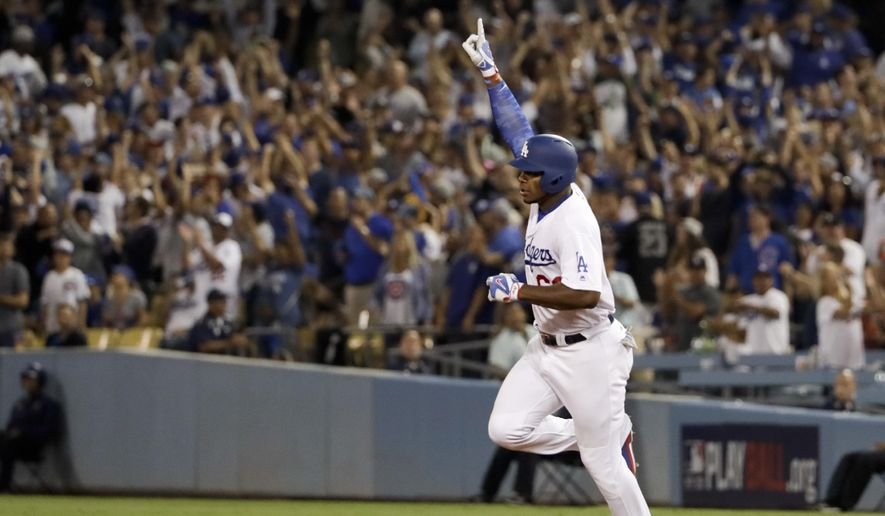 Los Angeles Dodgers' Yasiel Puig celebrates his home run against the Chicago Cubs during the seventh inning of Game 1 of baseball's National League Championship Series in Los Angeles, Saturday, Oct. 14, 2017. (AP Photo/Matt Slocum)