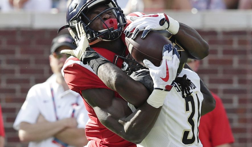 Mississippi wide receiver D.K. Metcalf (14) pulls in a pass reception over the defense of Vanderbilt cornerback Tre Herndon (31) in the first half of an NCAA college football game in Oxford, Miss., Saturday, Oct. 14, 2017. (AP Photo/Rogelio V. Solis)