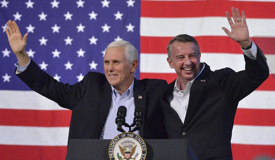 Vice President Mike Pence, left, joins Virginia Republican gubernatorial candidate Ed Gillespie onstage during a campaign rally at the Washington County Fairgrounds, Saturday, Oct. 14, 2017, in Abingdon, Va. Establishment figure Gillespie is in a neck-and-neck race against Democratic Lt. Gov. Ralph Northam. (Andre Teague/The Bristol Herald-Courier via AP)