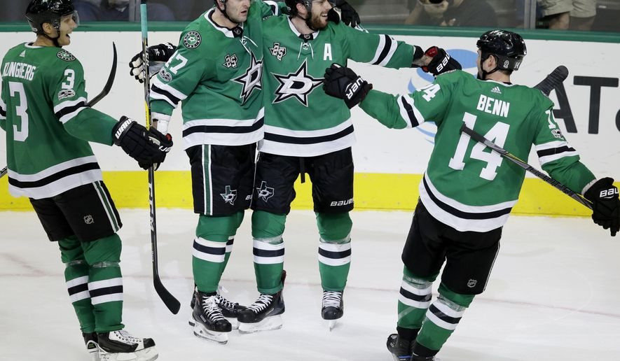 Dallas Stars center Tyler Seguin (91) celebrates his goal with teammates Alexander Radulov (47), Jamie Benn (14) and John Klingberg (3) during the second period of an NHL hockey game against the Colorado Avalanche in Dallas, Saturday, Oct. 14, 2017. (AP Photo/LM Otero)
