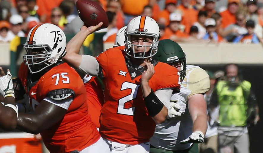 Oklahoma State quarterback Mason Rudolph (2) passes in the second quarter of an NCAA college football game against Baylor in Stillwater, Okla., Saturday, Oct. 14, 2017. (AP Photo/Sue Ogrocki)