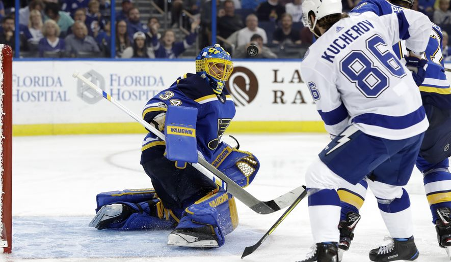 St. Louis Blues goalie Jake Allen (34) makes a stick-save against a shot by Tampa Bay Lightning right wing Nikita Kucherov (86), of Russia, during the second period of an NHL hockey game Saturday, Oct. 14, 2017, in Tampa, Fla. (AP Photo/Chris O'Meara)