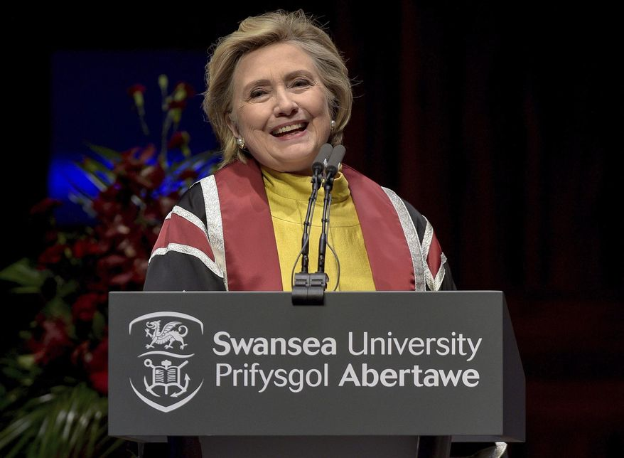 US politician Hillary Rodham Clinton delivers a speech during a ceremony where she received a Honorary Doctorate at Swansea University, in recognition of her commitment to promoting the rights of families and children around the world, in Swansea, Wales, Saturday, Oct. 14, 2017. (Ben Birchall/PA via AP)