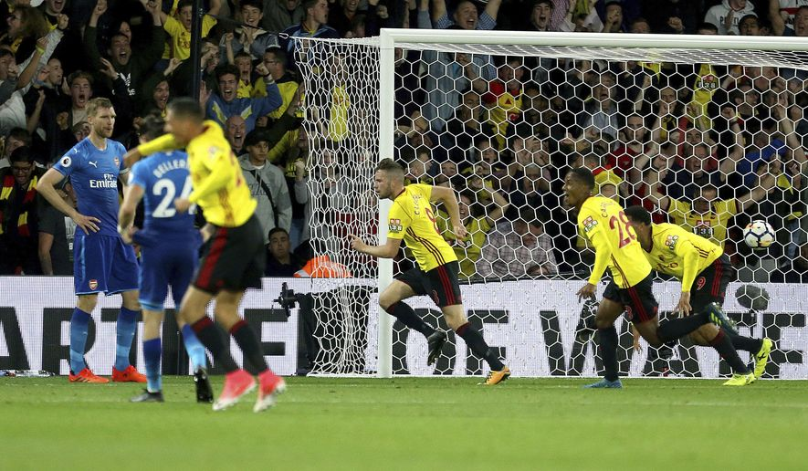 Watford's Tom Cleverley, center, celebrates scoring his side's second goal of the game during their English Premier League soccer match at Vicarage Road, Watford, England, Saturday, Oct. 14, 2017. (Steven Paston/PA via AP)