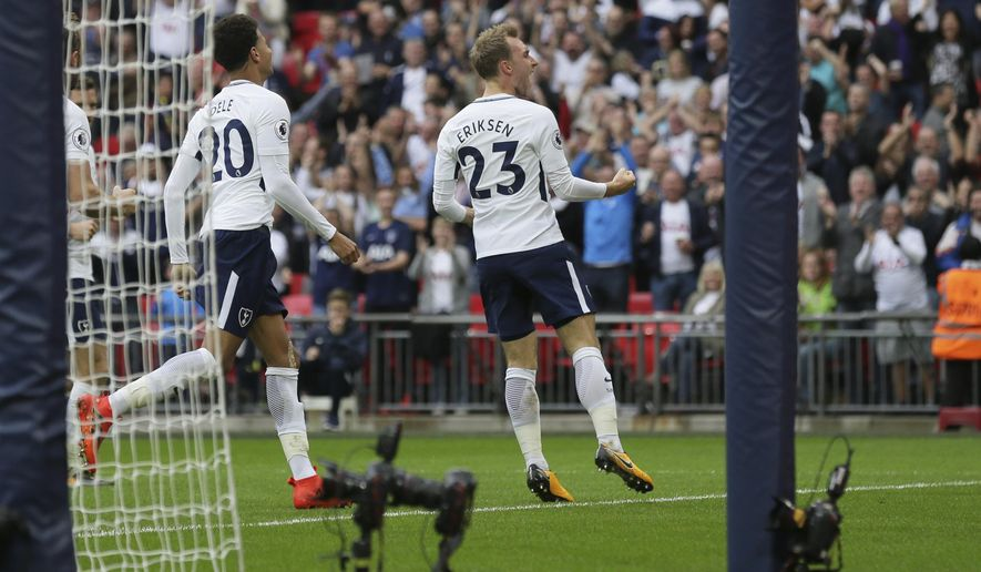 Tottenham's Christian Eriksen, right, celebrates after scoring a goal during the English Premier League soccer match between Tottenham Hotspur and AFC Bournemouth at Wembley stadium in London, Saturday Oct. 14, 2017. (AP Photo/Tim Ireland)