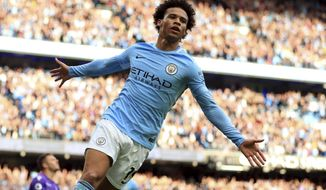Manchester City's Leroy Sane celebrates scoring his side's sixth goal of the game during the English Premier League soccer match between Manchester City and Stoke City at Etihad Stadium, Manchester, England, Saturday, Oct. 14, 2017. (Mike Egerton/PA via AP)