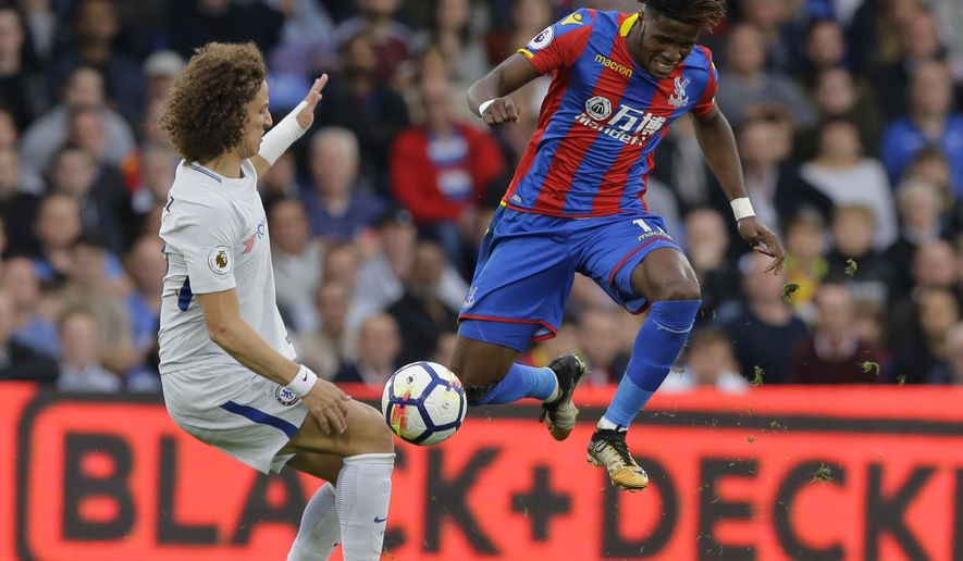Chelsea's David Luiz, left, vies for the ball with Crystal Palace's Wilfried Zaha during their English Premier League soccer match between Crystal Palace and Chelsea at Selhurst Park stadium in London, Saturday, Oct. 14, 2017. (AP Photo/Alastair Grant)
