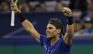 Rafael Nadal of Spain celebrates after winning his men's semifinals match against Marin Cilic of Croatia in the Shanghai Masters tennis tournament at Qizhong Forest Sports City Tennis Center in Shanghai, China, Saturday, Oct. 14, 2017. (AP Photo/Andy Wong)