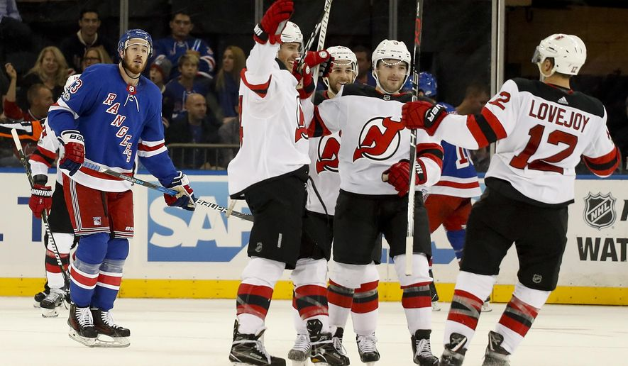 New Jersey Devils Miles Wood, second from left, celebrates with teammates after scoring a goal against the New York Rangers during the second period of an NHL hockey game game, Saturday, Oct. 14, 2017, in New York. (AP Photo/Julie Jacobson)