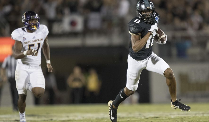 Central Florida wide receiver Cam Stewart (11) runs after catching a 42-yard-pass while chased by East Carolina linebacker Aaron Ramseur (51) during the first half of an NCAA college football game, Saturday, Oct. 14, 2017, in Orlando, Fla. (AP Photo/Willie J. Allen Jr.)