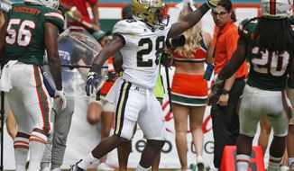 Georgia Tech running back J.J. Green (28) celebrates after scoring a touch down during the first half of an NCAA College football game against Miami, Saturday, Oct. 14, 2017 in Miami Gardens, Fla. (AP Photo/Wilfredo Lee)