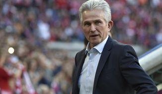 Bayern Munich's head coach  Jupp Heynckes arrives at the stadium prior to the match between FC Bayern Munich and SC Freiburg in Munich, Germany, Saturday, Oct. 14, 2017.  (Angelika Warmuth/dpa via AP)