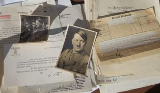 A collection of German Nazi Party documents from World War II that Ron Post found in an old bus he bought after it was confiscated by police in Eugene, Ore. Sept. 27, 2017. (Chris Pietsch/The Register-Guard via AP)