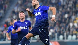 Lazio's Ciro Immobile celebrates after scoring, during the Serie A soccer match between Juventus and Lazio, at the Allianz Stadium in Turin, Italy, Sunday, Oct. 14, 2017. (Alessandro Di Marco/ANSA via AP)