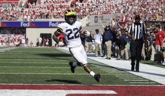 Michigan running back Karan Higdon scores a touchdown during the first half an NCAA college football game against Indiana in Bloomington, Ind., Saturday, Oct. 14, 2017. (AP Photo/AJ Mast)