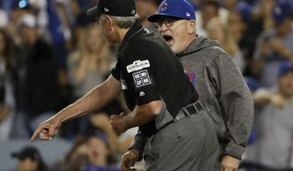 Chicago Cubs manager Joe Maddon, right, is thrown out by umpire Mike Winters during the seventh inning of Game 1 of baseball's National League Championship Series against the Los Angeles Dodgers in Los Angeles, Saturday, Oct. 14, 2017. (AP Photo/Matt Slocum)