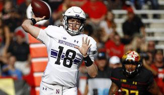 Northwestern quarterback Clayton Thorson throws to a receiver in the first half of an NCAA college football game against Maryland in College Park, Md., Saturday, Oct. 14, 2017. (AP Photo/Patrick Semansky)