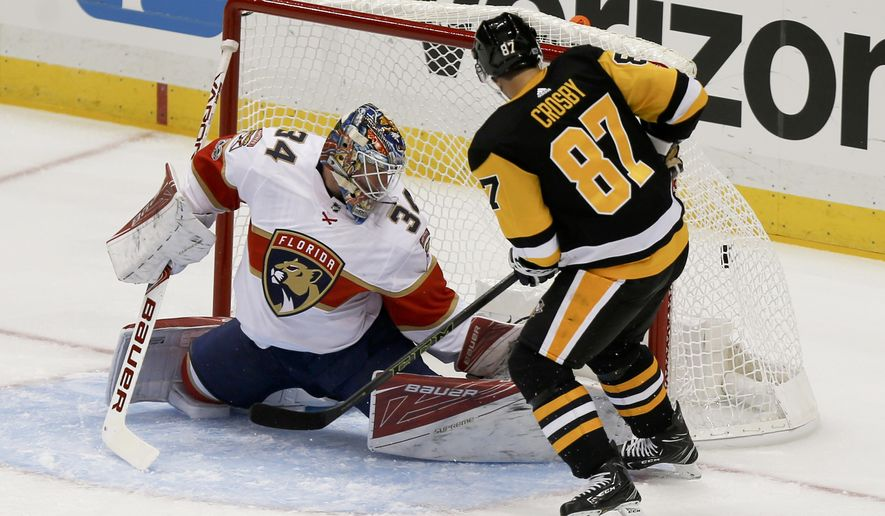 Pittsburgh Penguins' Sidney Crosby, right, scores a goal on Florida Panthers goalie James Reimer in the first period the NHL hockey game, Saturday, Oct. 14, 2017, in Pittsburgh. (AP Photo/Keith Srakocic)
