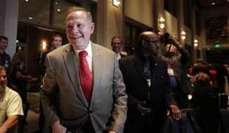 U.S. Senate candidate Roy Moore greets supporters before his election party in Montgomery, Ala., on Sept. 26, 2017. (Associated Press) **FILE**