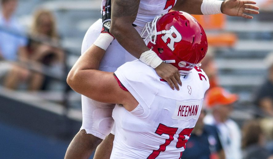 Rutgers offensive lineman Zack Heeman (79) lifts running back Robert Martin (7) after Martin's touchdown run during the fourth quarter of an NCAA college football game against Illinois, Saturday, Oct. 14, 2017, at Memorial Stadium in Champaign, Ill. Rutgers defeated Illinois 35-24. (AP Photo/Bradley Leeb)