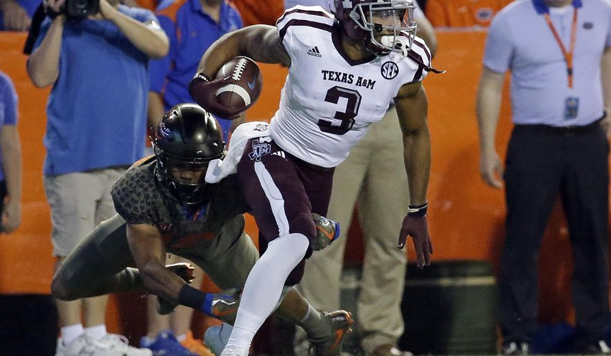Texas A&M's Christian Kirk (3) returns a punt as Florida defensive back C.J. McWilliams can't make the tackle during the first half of an NCAA college football game, Saturday, Oct. 14, 2017, in Gainesville, Fla. (AP Photo/John Raoux)