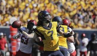 West Virginia quarterback Will Grier (7) attempts a pass during the first half of an NCAA college football game against Texas Tech, Saturday, Oct. 14, 2017, in Morgantown, W.Va. (AP Photo/Raymond Thompson)