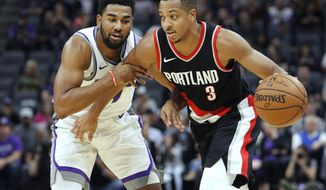 FILE - In this Oct. 9, 2017, file photo, Portland Trail Blazers guard CJ McCollum, right, is fouled by Sacramento Kings defender Matt Jones during the first half of an NBA preseason basketball game in Sacramento, Calif. Portland didn't make a lot of changes in the offseason as the team remains anchored by the backcourt duo of Damian Lillard and McColllum. (AP Photo/Steve Yeater, File)