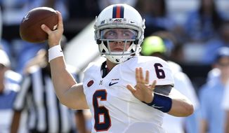 Virginia quarterback Kurt Benkert (6) passes against North Carolina during the first half an NCAA college football game in Chapel Hill, N.C., Saturday, Oct. 14, 2017. (AP Photo/Gerry Broome)
