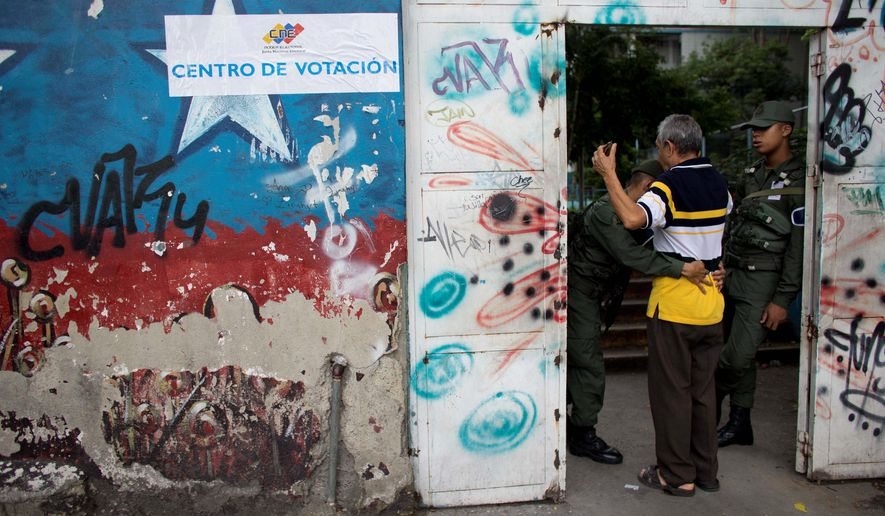 "A pro-Maduro council relocated more than 200 polling places for Venezuleans, many of them city residents who were forced to travel to remote ""barrios"" to vote. However, the move, seen as an oppressive tactic, only strengthened the resolve of many to vote. (Associated Press)"