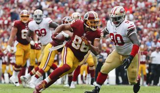 Washington Redskins tight end Jordan Reed (86) carries the ball during the first half of an NFL football game against the San Francisco 49ers in Landover, Md., Sunday, Oct. 15, 2017. (AP Photo/Alex Brandon)