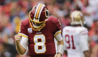 Washington Redskins quarterback Kirk Cousins (8) celebrates wide receiver Josh Doctson's touchdown during the first half of an NFL football game against the San Francisco 49ers in Landover, Md., Sunday, Oct. 15, 2017. (AP Photo/Mark Tenally)