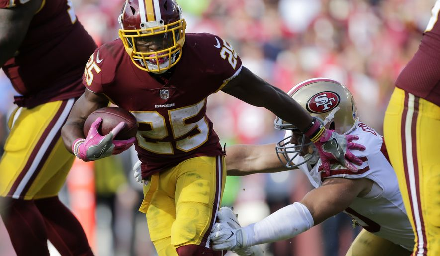 Washington Redskins running back Chris Thompson (25) runs the ball during an NFL football game against the San Fransisco 49ers, Sunday, Oct. 15, 2017, in Landover, Md. (AP Photo/Mark Tenally)