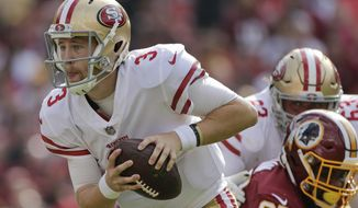 San Francisco 49ers quarterback C.J. Beathard (3) scrambles with the ball during the first half of an NFL football game against the Washington Redskins in Landover, Md., Sunday, Oct. 15, 2017. (AP Photo/Mark Tenally)