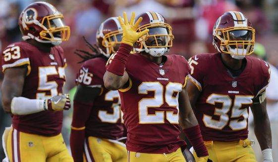 Washington Redskins cornerback Kendall Fuller (29) celebrates his interception in the closing seconds of the second half of an NFL football game against the San Francisco 49ers in Landover, Md., Sunday, Oct. 15, 2017. The Redskins defeated the 49er 26-24. (AP Photo/Mark Tenally) ** FILE **
