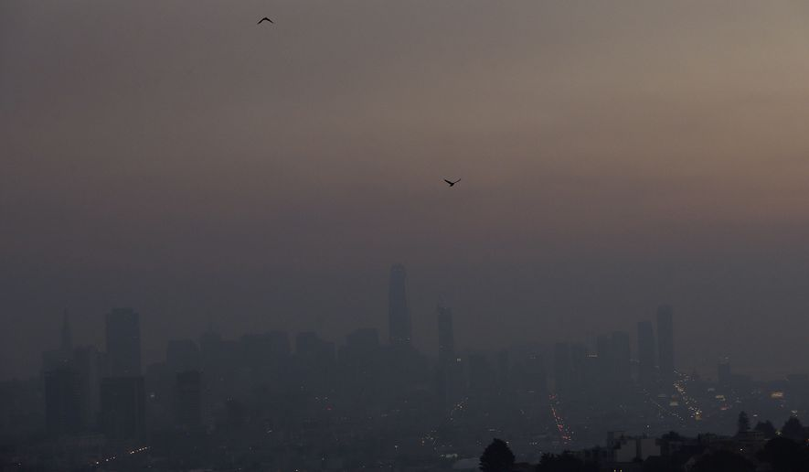 Smoke from regional wildfires obscures the skyline in San Francisco, Thursday, Oct. 12, 2017. (AP Photo/Jeff Chiu)