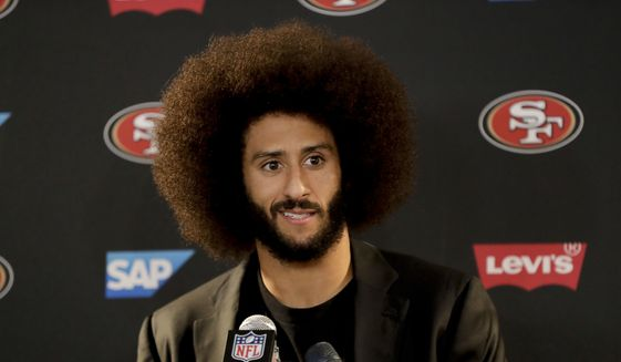 This Dec. 24, 2016, file photo shows San Francisco 49ers quarterback Colin Kaepernick talking during a news conference after an NFL football game against the Los Angeles Rams. Kaepernick filed a grievance against the NFL on Sunday, Oct. 15, 2017 alleging that he remains unsigned as a result of collusion by owners following his protests during the national anthem. (AP Photo/Rick Scuteri)
