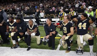 People in the crowd boo as members of the New Orleans Saints kneel for a moment of silence for fallen New Orleans Police officer Marcus McNeil, prior to the National Anthem, before an NFL football game against the Detroit Lions in New Orleans, Sunday, Oct. 15, 2017. The players stood for the National Anthem. (AP Photo/Gerald Herbert)