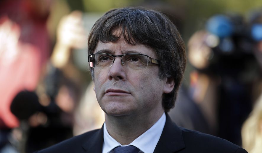 Catalan regional President Carles Puigdemont attends a ceremony commemorating the 77th anniversary of the death of Catalan leader Lluis Companys at the Montjuic Cemetery in Barcelona, Spain, Sunday, Oct. 15, 2017. (AP Photo/Manu Fernandez)