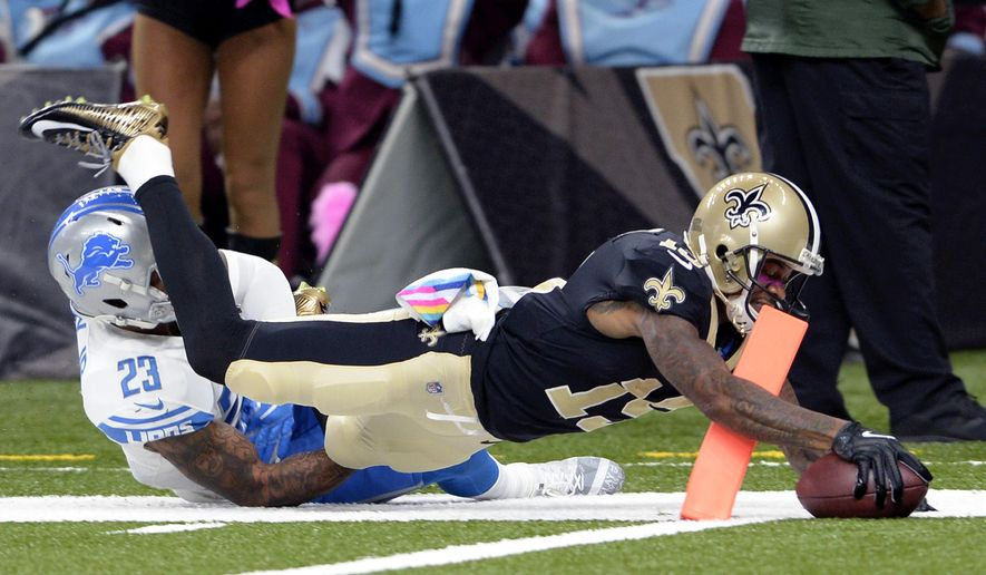 New Orleans Saints wide receiver Ted Ginn (19) breaks past Detroit Lions cornerback Darius Slay on a touchdown reception in the first half of an NFL football game in New Orleans, Sunday, Oct. 15, 2017. (AP Photo/Bill Feig)